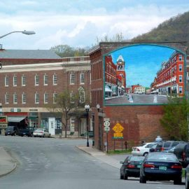 Living History Historical Mural painted on the side of a building in Bellows Falls, Vermont by Charles C. Clear III and Bonnie Lee Turner
